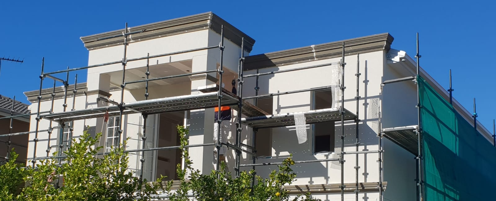 Scaffolding around a residential property in Sydney with rendering works done